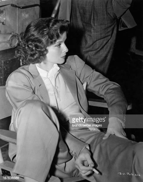The actress Katharine Hepburn sitting dresses in suit Photograph About 1938 Die Schauspielerin Katharine Hepburn sitzend im Anzug Photographie Um 1938