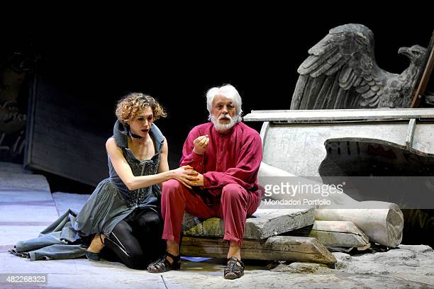 The actress Linda Gennari as Regan King Lear's secondborn daughter consoles Michele Placido who sits on the ruins the stage is full with and has a...