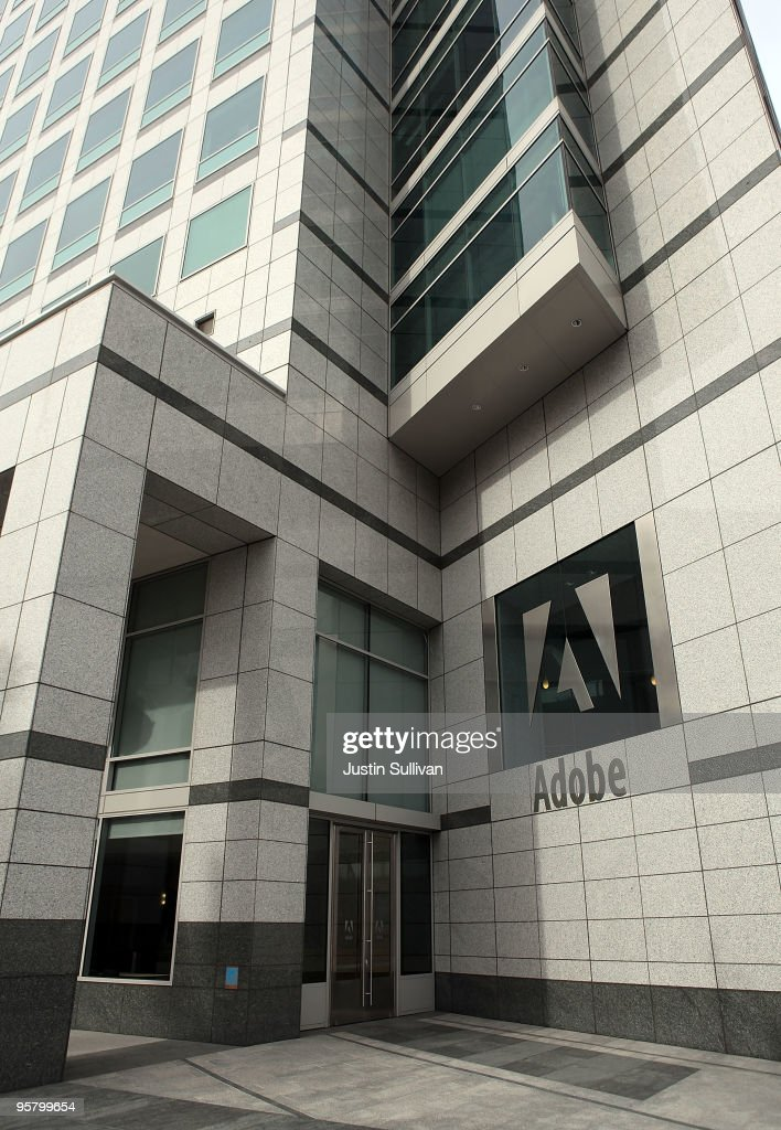 The Adobe logo is displayed on the side of the Adobe Systems headquarters January 15, 2010 in San Jose, California. Adobe Systems has added 20 new wind turbines to their rooftops in an attempt to harness wind energy to help power their offices. Each 30 foot tall aluminum wind turbine is capable of capturing a maximum of 1.2 kilowatts of electricty.