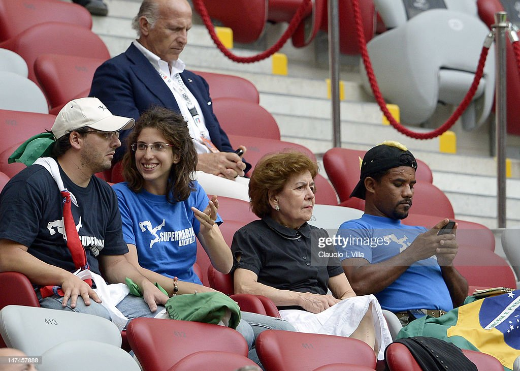 (L-R) The adoptive family of Mario Balotelli, (L-2nd R) brother Corrado Balotelli, sister Cristina Balotelli and mother Silvia Balotelli look on during the UEFA EURO 2012 semi final match between Germany and Italy at National Stadium on June 28, 2012 in Warsaw, Poland.