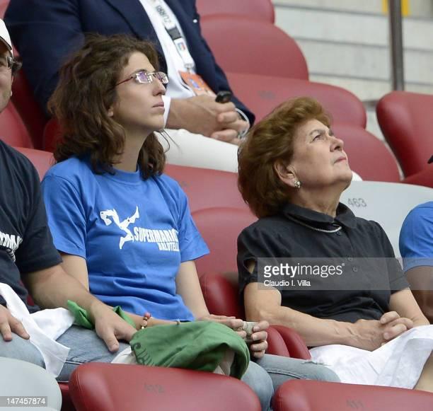 The adoptive family of Mario Balotelli sister Cristina Balotelli and mother Silvia Balotelli look on during the UEFA EURO 2012 semi final match...
