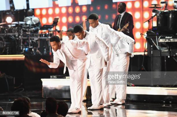 The adult cast of 'The New Edition Story' performs onstage at 2017 BET Awards at Microsoft Theater on June 25 2017 in Los Angeles California