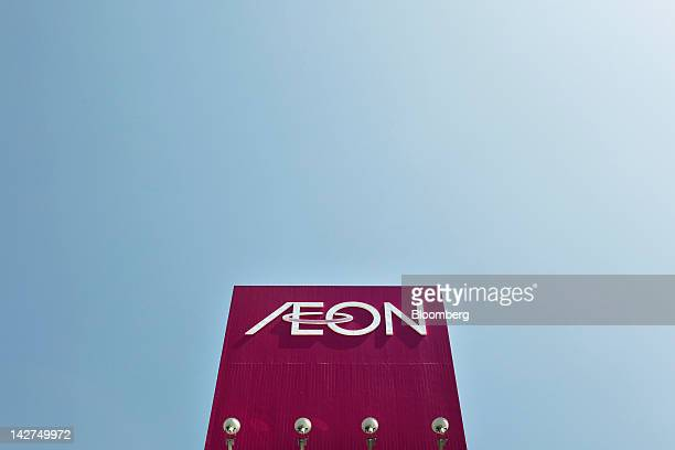 The Aeon Co logo is displayed atop the company's supermarket in Tokyo Japan on Thursday April 12 2012 Aeon Co Japan's largest supermarket operator...