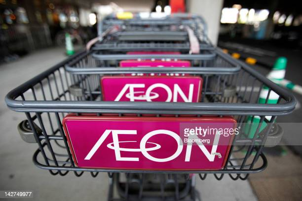The Aeon Co logo is displayed on shopping carts outside the company's shopping center in Tokyo Japan on Thursday April 12 2012 Aeon Co Japan's...