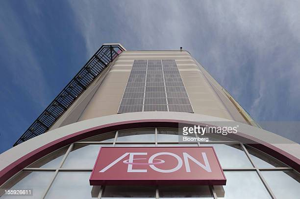 The Aeon Co logo is displayed on the exterior of the company's shopping center in Tokyo Japan on Friday Nov 9 2012 Aeon Co is Japan's largest...