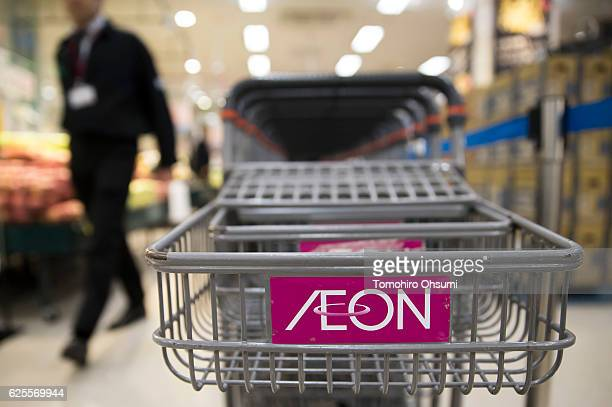 The Aeon logo is seen on a shopping cart at an Aeon supermarket on November 25 2016 in Tokyo Japan Japan's largest retailer Aeon held the Black...