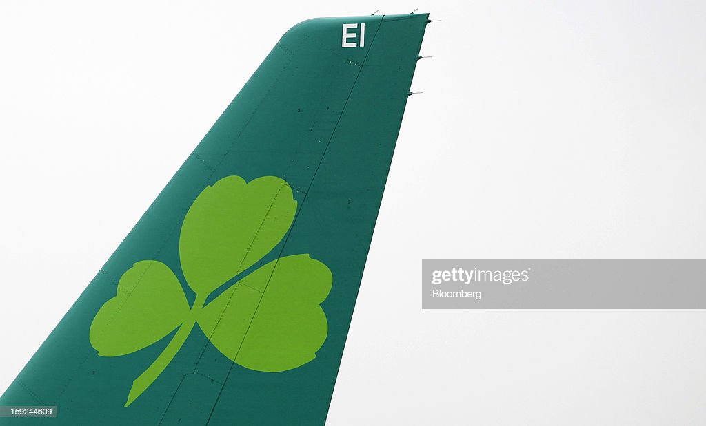 The Aer Lingus Group Plc company logo, a shamrock, is seen on the tailfin of an Airbus A320 aircraft at Gatwick airport in Crawley, U.K., on Wednesday, Jan. 9, 2013. Gatwick, acquired by Global Infrastructure Partners Ltd. in 2009 after regulators sought a breakup of BAA Ltd., owner of the larger Heathrow hub, is 30 miles (48 kilometers) south of London and serves about 200 destinations, more than any other U.K. airport, according to flight schedule data provider OAG. Photographer: Chris Ratcliffe/Bloomberg via Getty Images