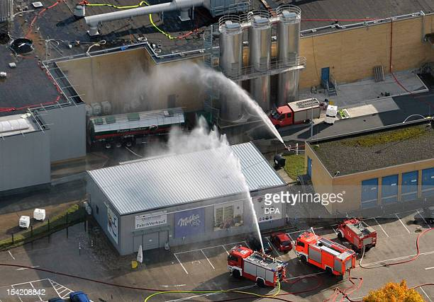 The aerial shows fire trucks standing on the premises of a Kraft Foods plant after a chemical accident in Bad Fallingbostel Germany on October 16...