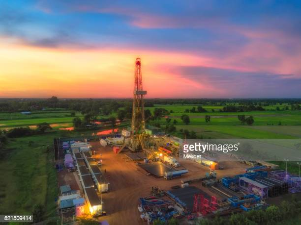 The Aerial view of PTTEP company's Oil Drilling rig and the rice field of Chum Saeng Songkhram district, Phitsanulok, Thailand