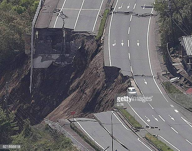 The aerial view shows a collapsed road after an earthquake in MinamiAso Kumamoto prefecture on April 16 2016 A powerful 70 magnitude earthquake hit...
