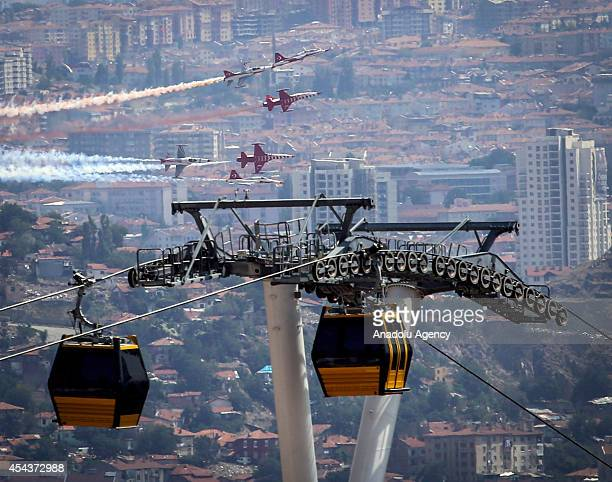 The aerobatic demonstration team of the Turkish Air Force 'Turkish Stars' perform during a military parade marking the 92nd anniversary of the...