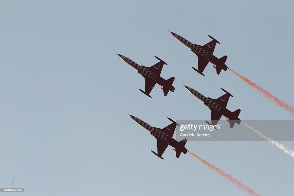 The aerobatic demonstration team of the Turkish Air Force 'Turkish Stars' perform during the 92nd anniversary of liberation day of Izmir Turkey on...