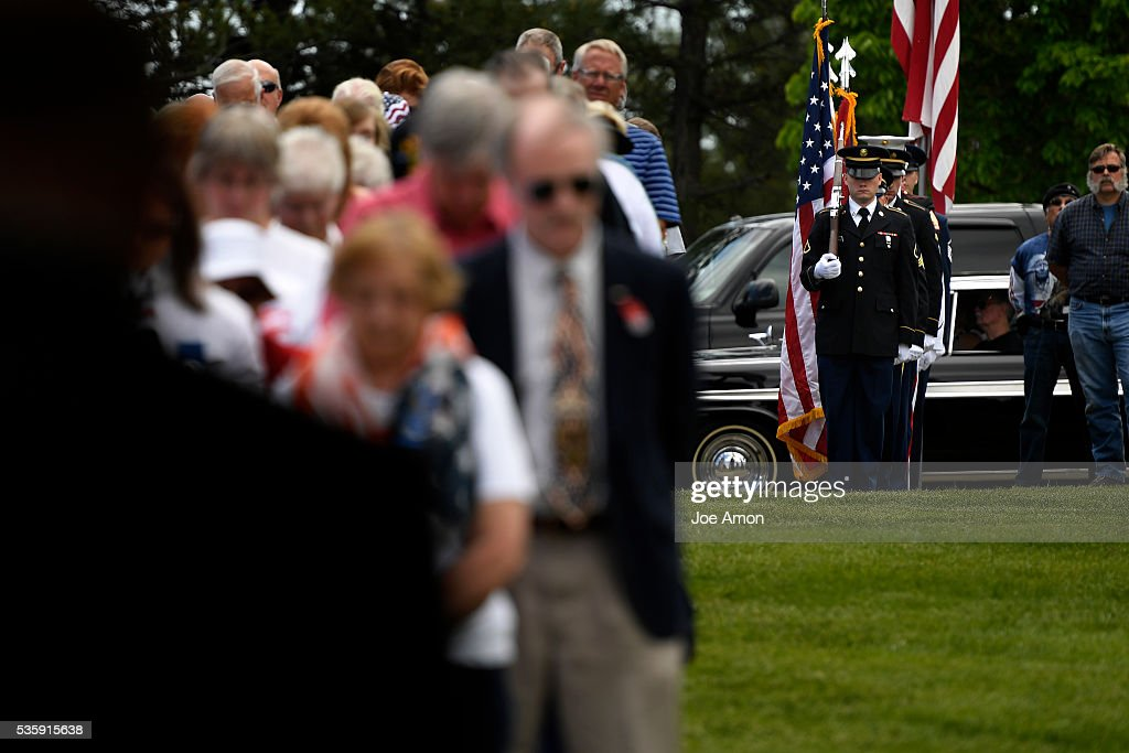 The Aerospace Data Facility Joint Color Guard makes ready to present the Colors at the Memorial Day ceremony, 84th Anniversary of Remembrance at Fort Logan National Cemetery. May 30, 2016 in Denver, CO.