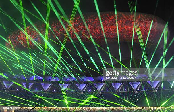 The aerostat is seen past a laser light show during the Commonwealth Games closing ceremony at the Jawaharlal Nehru stadium in New Delhi on October...