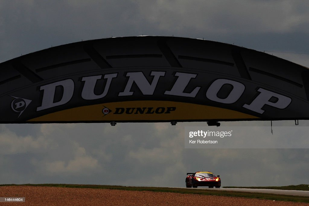 The AF Corse Michael Waltrip Racing Ferrari 458 of Robert Kauffman Rui Aguas and Brian Vickers drive during the Le Mans 24 Hour race at the Circuit...
