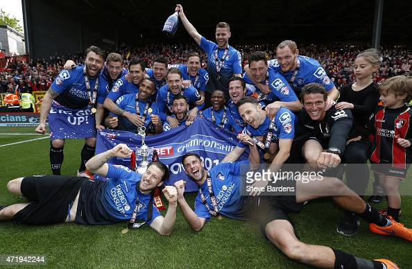The AFC Bournemouth players pose with the trophy after winning the Championship during the Sky Bet Championship match between Charlton Athletic and...