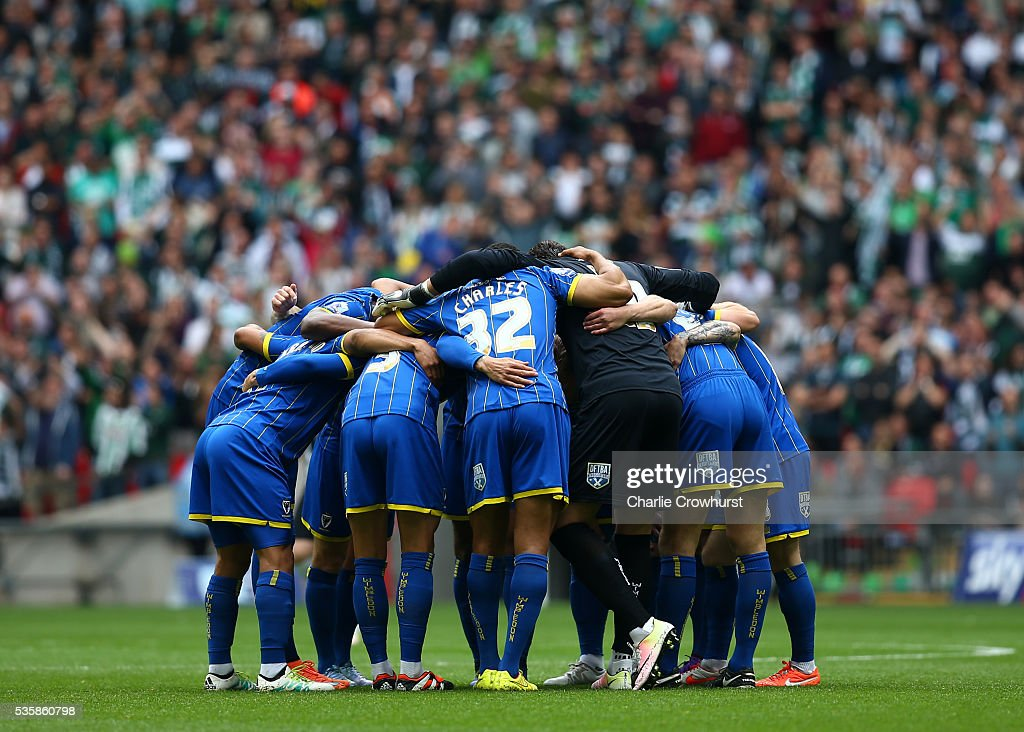 The AFC Wimbledon team huddle during the Sky Bet League 2 Play Off Final between Plymouth Argyle and AFC Wimbledon at Wembley Stadium on May 30, 2016 in London, England.