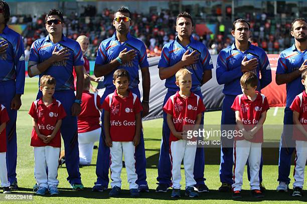 The Afghanistan cricket team lined up for the national anthems during the 2015 ICC Cricket World Cup match between New Zealand and Afghanistan at...