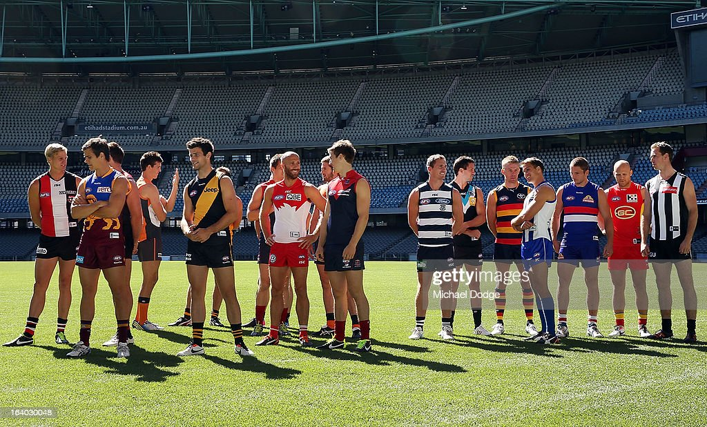 The AFL team captains talk to each other during the AFL Captains media Day at Etihad Stadium on March 19, 2013 in Melbourne, Australia.