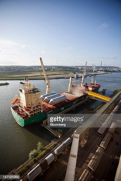 The 'African Wind' cargo ship sits moored at Lecureur SA's cereal plant as grain is loaded into her hull on the banks of the River Seine in Val de la...