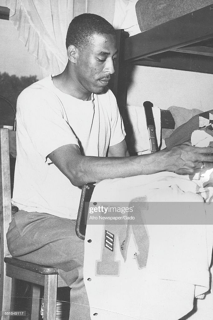 The AFRO cameraman Bob Tyler packing his kit for a running race, and the caption reads Bob is as meticulous as he is fast, 1943.
