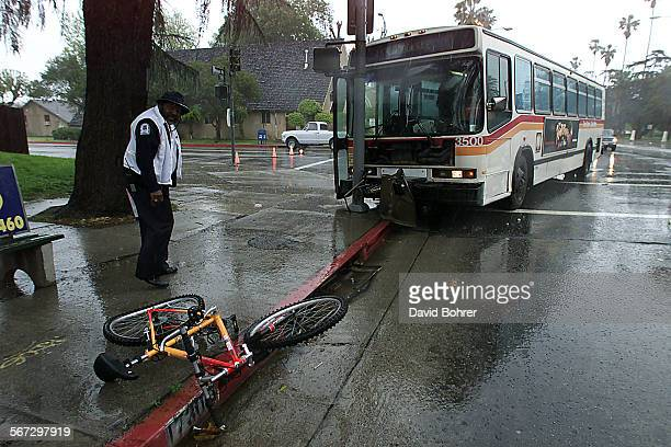 The aftermath of a accident that occurred at Sherman Way and Louise Ave just before noon Monday that involved a bicycle an MTA bus and a Ford Taurus...
