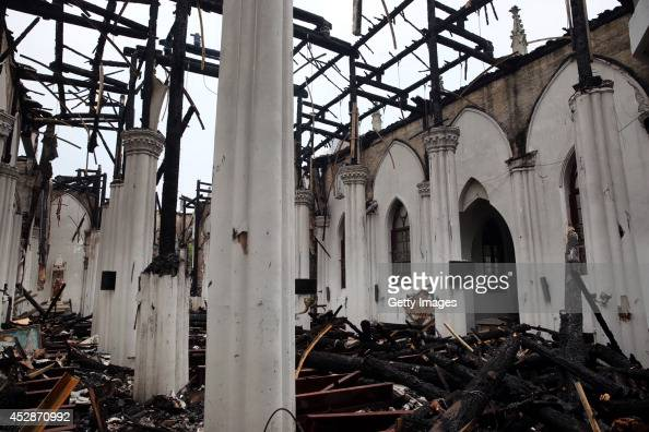 The aftermath of a centuryold Christianity church at the old bund burnt by a fire is seen on July 28 2014 in Ningbo Zhejiang province of China The...