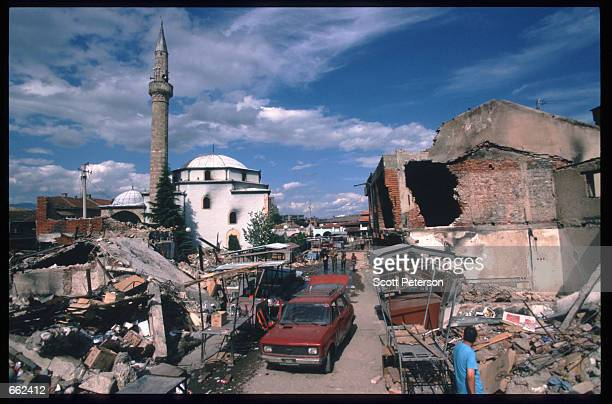 The aftermath of a recent bombing August 16 1999 in Pec Kosovo Yugoslavia Kosovo Peacekeeping Force soldiers fail to protect Ethnic Albanians and...