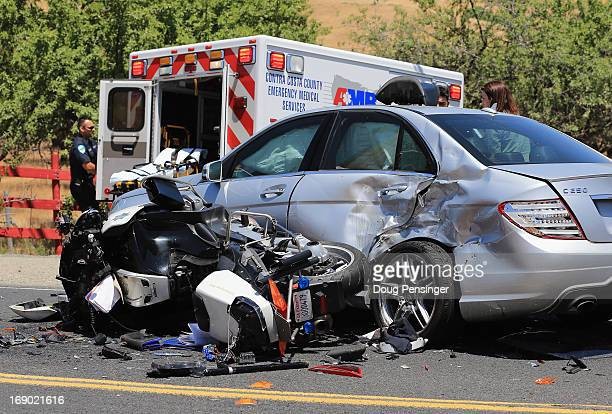 The aftermath of an accident remains in the road after a California Highway Patrol motorcycle officer providing traffic control for the race collided...