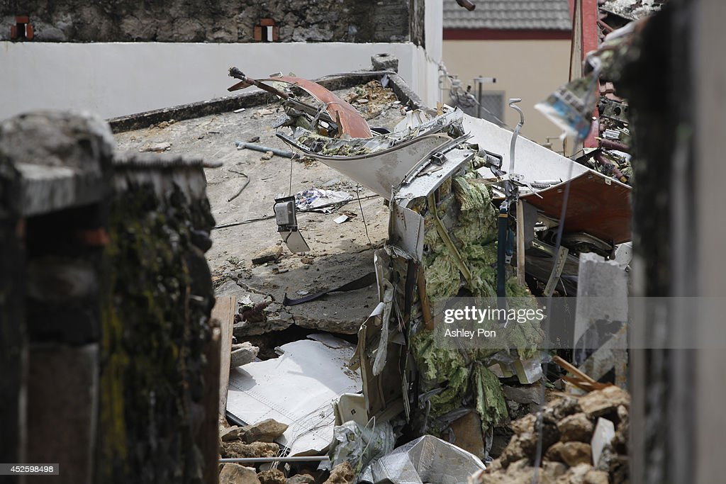 The aftermath of the wreckage of TransAsia Airways flight GE222 after it crashed the night before near the airport at Magong on July 24 2014 in...