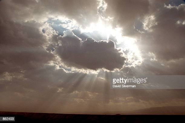 The afternoon sun breaks through the clouds over the Jordan Valley area of the West Bank January 3 2001 Under US President Bill Clinton's peace...