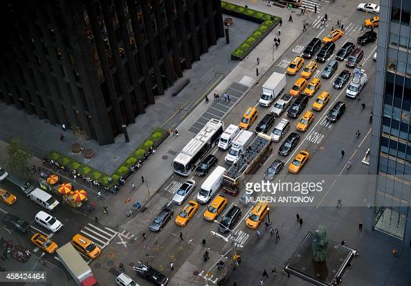 The afternoon traffic is seen at the intersection of 52nd Street and the Avenue of the Americas in Manhattan on November 04 2014 in New York AFP...