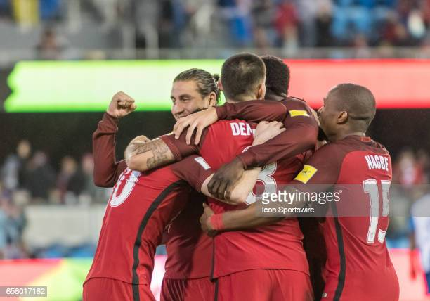 The against the US Men's National Team celebrate a goal by US forward Clint Dempsey during the FIFA World Cup Qualifier between the US Men's National...