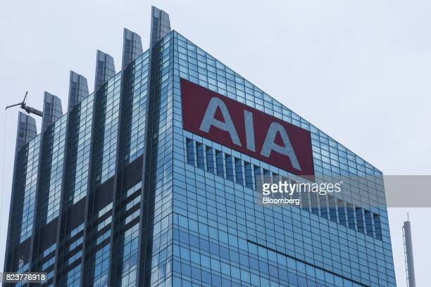 The AIA Group Ltd logo is displayed on a screen atop the AIA Central building in Hong Kong China on Friday July 28 2017 AIA the world's secondbiggest...