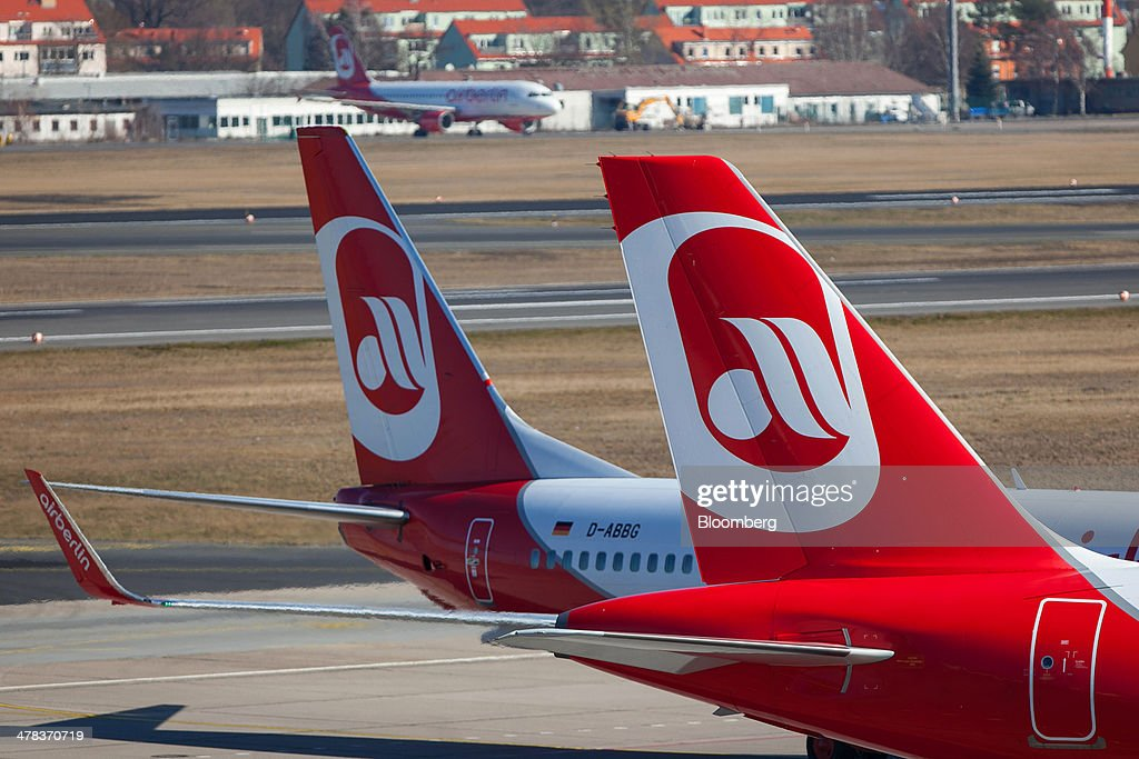 The Air Berlin logo sits on tail fins of aircraft on the tarmac at Tegel airport, operated by Flughafen Berlin Brandenburg GmbH, in Berlin, Germany, on Wednesday, March 12, 2014. Berlin's Tegel airport has subsisted by chance alone, defying the odds as passenger growth outpaces every other major hub in Western Europe. Photographer: Krisztian Bocsi/Bloomberg via Getty Images