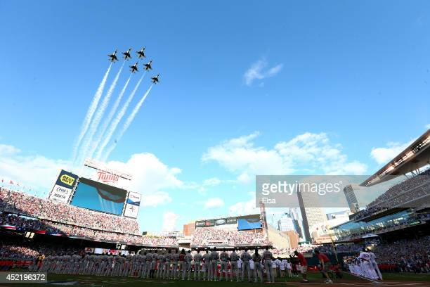 The Air Force Thunderbirds perform a flyover during the national anthem prior to the 85th MLB AllStar Game at Target Field on July 15 2014 in...