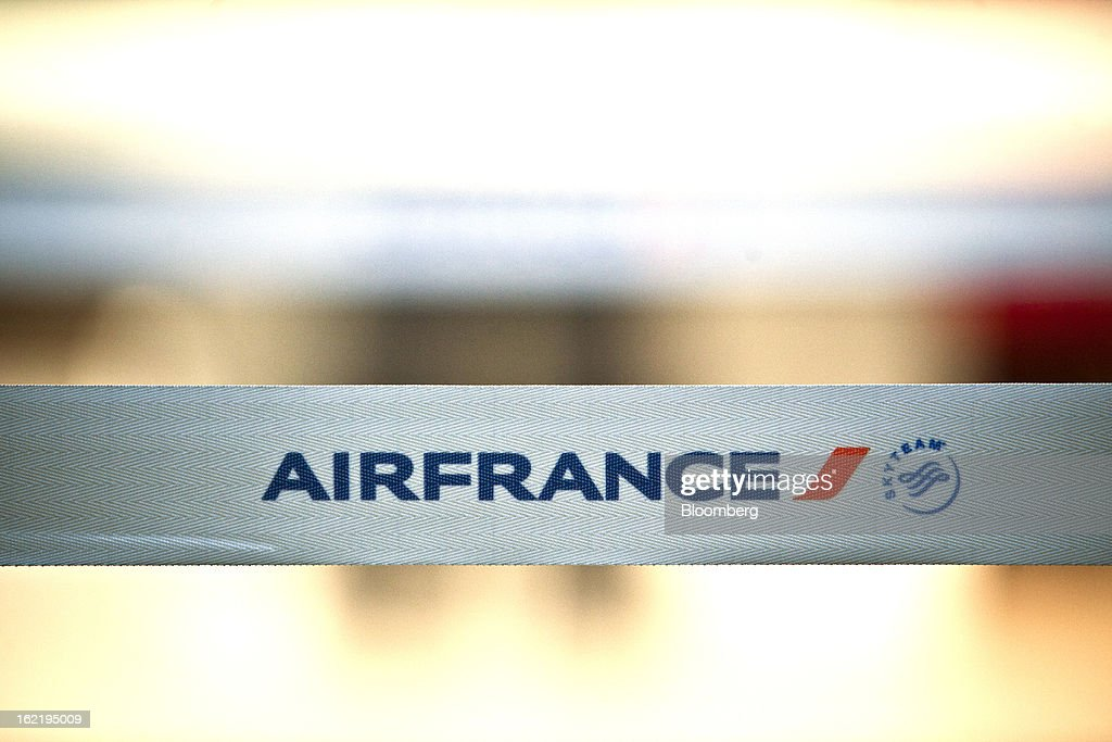 The Air France logo, part of the Air France-KLM Group and a member of SkyTeam, the global airline alliance, is seen at their check-in area at Toulouse-Blagnac airport in Toulouse, France, on Tuesday, Feb. 19, 2013. Air France-KLM, Europe's biggest airline, has been revamping its regional operations in an effort to end years of losses. Photographer: Balint Porneczi/Bloomberg via Getty Images