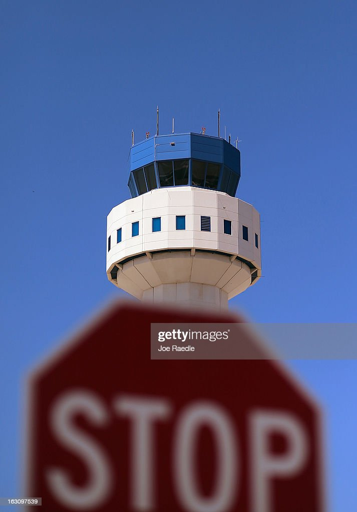 The air traffic control tower is seen at Opa-locka airport on March 4, 2013 in Opa-locka, Florida. Due to sequestration cuts, small airports such as Opa-locka, which is a popular spot for corporate jets to land, will close its control tower in April to save federal transportation dollars under the federal spending cuts that went in to affect last week. Even though the control tower will close, planes will still be able to use the airport just without the help from the control tower.
