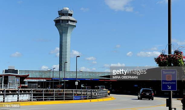 The air traffic control tower is seen behind the departures level of terminal 2 at Chicago's O'Hare airport on August 13 2013 The US Justice...