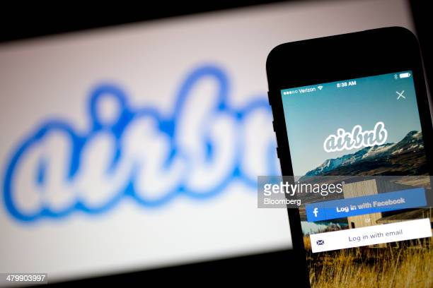 The Airbnb Inc application and logo are displayed on an Apple Inc iPhone and iPad in this arranged photograph in Washington DC US on Friday March 21...