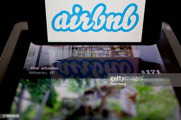 The Airbnb Inc logo and application are displayed on an Apple Inc iPhone and iPad in this arranged photograph in Washington DC US on Friday March 21...