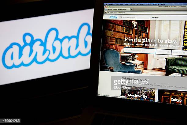 The Airbnb Inc logo and website are displayed on laptop computers in this arranged photograph in Washington DC US on Friday March 21 2014 Airbnb Inc...