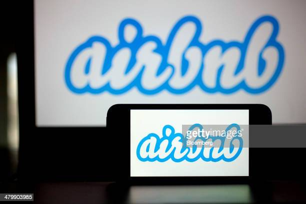 The Airbnb Inc logo is displayed on an Apple Inc iPhone and iPad in this arranged photograph in Washington DC US on Friday March 21 2014 Airbnb Inc...