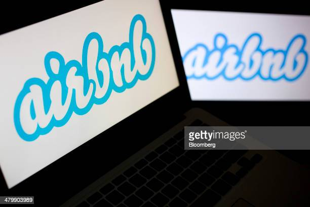 The Airbnb Inc logo is displayed on laptop computers in this arranged photograph in Washington DC US on Friday March 21 2014 Airbnb Inc is raising...
