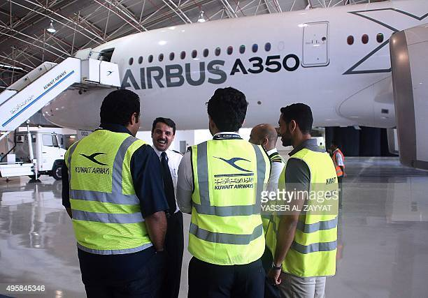 The Airbus A350900 XWB is presented to Kuwait Airways officials during a demonstration of the plane at the at International Airport in Kuwait City on...