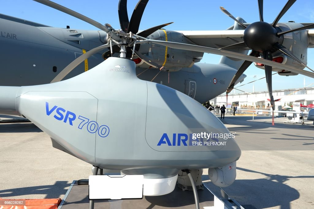 The Airbus Helicopters' VSR700 Optionally Piloted Vehicle (OPV) demonstrator is presented on the tarmac in front of the Airbus A 400M at the Airbus pavillon at Le Bourget on June 20, 2017 during the International Paris Air Show. /