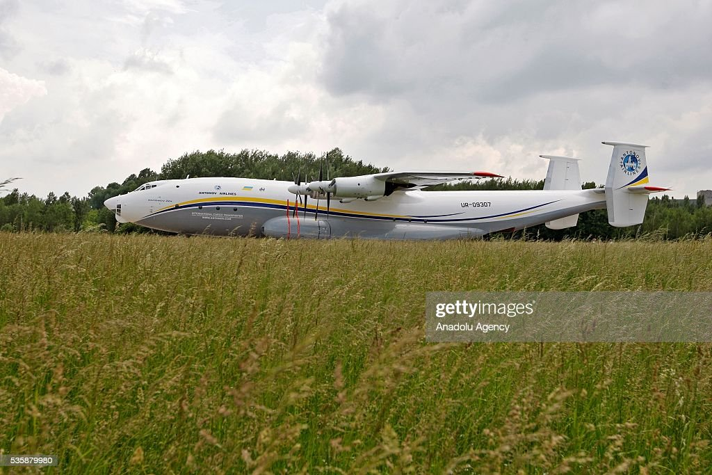 The aircraft 'AN-22' ('Antaeus') stands on the ground before a demonstration flight from the airfield 'Svyatoshin' (Kiev) to the airport 'Kyiv-Antonov' (Hostomel) in Kiev, Ukraine on May 30, 2016. Ukrainian aircraft 'AN-22' is restored on the aircraft factory 'Antonov' and returned to commercial operation. The 'AN-22' is the world's first wide-body transport plane and the world's largest turbo-prop airplane.
