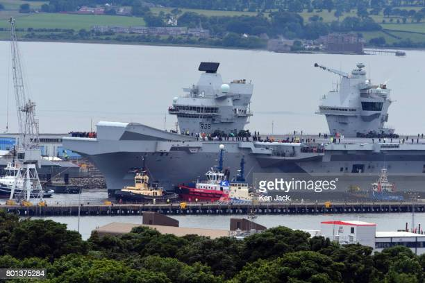The aircraft carrier HMS Queen Elizabeth leaves Rosyth dockyard to begin sea trials before entering service with the fleet on June 26 2017 in Rosyth...