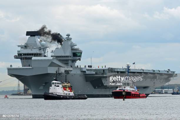 The aircraft carrier HMS Queen Elizabeth makes smoke as she leaves Rosyth dockyard to begin sea trials before entering service with the fleet on June...