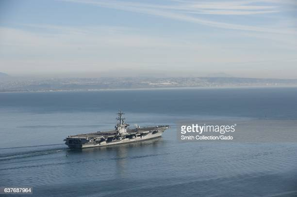 The aircraft carrier USS Carl Vinson gets underway from Naval Air Station North Island to conduct sea trials Pacific Ocean February 2013 Image...